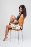 model sitting Arkivbild