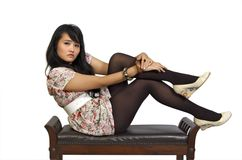 Model sitting on chair Royalty Free Stock Photos