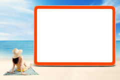 Model sitting at coast and look at billboard Royalty Free Stock Photo