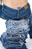 Model sitting on jeans Royalty Free Stock Photography