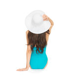 Model sitting in swimsuit with hat Stock Image