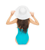 Model sitting in swimsuit with hat Stock Photography