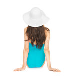 Model sitting in swimsuit with hat Royalty Free Stock Photography