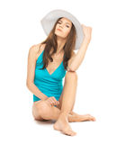 Model sitting in swimsuit with hat Stock Photos