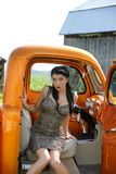 Model sitting in the truck. Picture or the beautiful young woman sitting in a classic truck Stock Photography