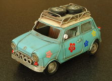 Model of Small Car. A model of a small car with spare tyres on a roof rack Stock Images