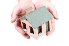 Model of the small house in human hand Stock Photo