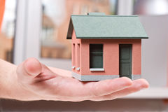 Model of the small house in human hand Stock Image
