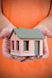 Model of the small house in human hand Stock Photos