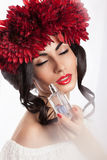 Model smelling a perfume Royalty Free Stock Images