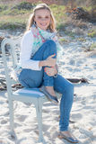 Model smiling casual wear. Sitting on chair stock photos