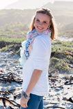 Model smiling casual wear. Standing at beach stock photo