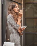 Model smoking outside Missoni fashion shows building for Milan Women's Fashion Week 2014 Stock Photography
