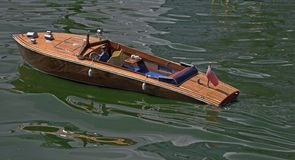 Model Speed Boat. Model boat in the water Royalty Free Stock Photo