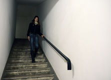 Model on staircase. Model walking down on a staircase royalty free stock photography