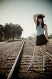 Model standing on train tracks Royalty Free Stock Image