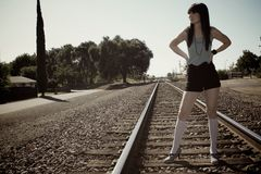Model standing on train tracks Royalty Free Stock Images