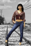 Model standing on Train Tracks. Pretty model standing on train tracks at the Hawaiian Railway on Oahu Royalty Free Stock Photography