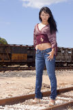 Model standing on Train Tracks. Pretty model standing on train tracks at the Hawaiian Railway on Oahu stock photo