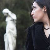 Model and statue. Photo of model and statue Royalty Free Stock Photos