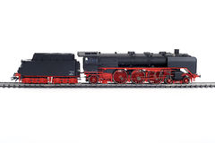 Model of steam train. On railway track, isolated on white background Royalty Free Stock Photography