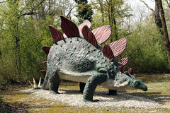 Model of Stegosaurus Dinosaurin Outdoor Theme Park. Three Quarter View of Model of Stegosaurus Dinosaur from Late Jurassic Period with Tail Spikes and Armored Royalty Free Stock Photos