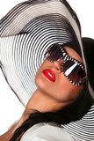 Model in striped hat and sunglasse. Beautiful model in striped hat and sunglasses on the white background Stock Photo