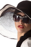 Model in striped hat and sunglasse. Beautiful model in striped hat and sunglasses on the white background Royalty Free Stock Photography