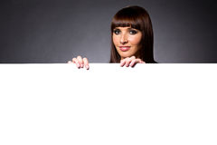 Model in Studio Behind Large Blank Sign Royalty Free Stock Photo