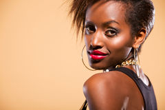 Model in Studio Looking over Shoulder Royalty Free Stock Photography