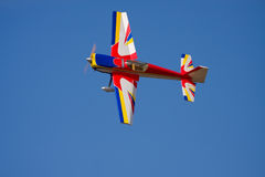 A model stunt plane spinning. An R/C model stunt plane doing right hand spins for the crowd Stock Photo