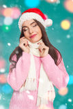 Model in sweater and christmas hat Royalty Free Stock Photo