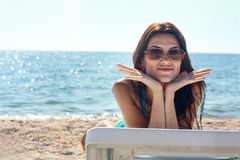 Model in swimsuit on the beach Stock Photography
