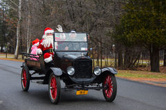 Model T Ford carrying Santa Claus Royalty Free Stock Images