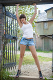 Model in a t-shirt and denim shorts Stock Images