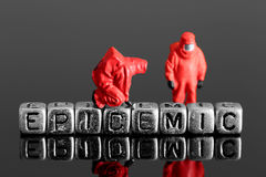 Model team in chemical suits with the word epidemic on beads Royalty Free Stock Image