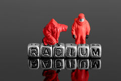Model team in chemical suits with the word radium on beads Royalty Free Stock Photos