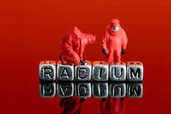 Model team in chemical suits with the word radium on beads Royalty Free Stock Photo