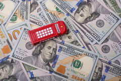 Model telephone booth is on the US dollar banknotes Royalty Free Stock Photography
