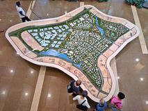 Model of Tengah forest town. Visitors viewing a large model of the development plan of Tengah forest town in HDB Hub exhibition gallery in Singapore Stock Image