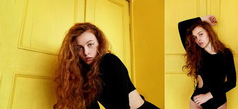 Model tests. Beautiful redhead girl with curly hair.Natural color. Great contrast with yellow wooden doors. Model tests. Beautiful redhead girl with curly hair stock image