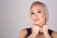 Model with tied neck by her hair. Close up. Gray background stock photography