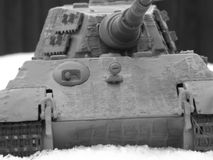 Model tiger tank up close shot in snow. Model tigerbtanknclose up shot innsnow to make it look real black and white photo to make it look original royalty free stock image