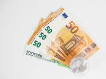 The model tooth is standing on the money in the euro currency on the white background. 100 Royalty Free Stock Photos