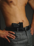 Model torso with gun Royalty Free Stock Image