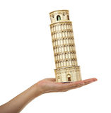 Model Tower of Pisa in the women's hand. Royalty Free Stock Image