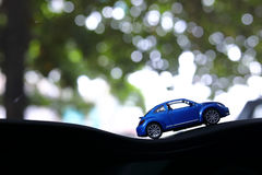 Model toy car with bokeh green natural background. Toy car with bokeh green natural background, vehicle travel road trip in adventure nature destination royalty free stock images
