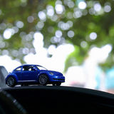 Model toy car with bokeh green natural background. Vehicle travel road trip in adventure nature destination, model toy blue car with bokeh green natural royalty free stock photos