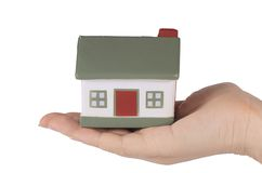 Model toy house in hand  isolated on white Royalty Free Stock Photo