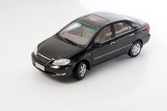 Model Toyota Corolla. Black Toyota Corolla miniature replica with shadow isolated on white background Stock Photos